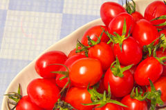 Vegetables. Fresh tomatoes, place in dish Stock Image