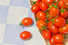 Vegetables. Fresh tomatoes, place in dish Royalty Free Stock Photography
