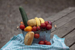 Vegetables. Basket with vegetables and fruits royalty free stock photography