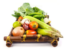 Vegetables. On wood tray on white background Stock Image