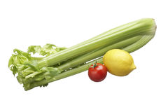 Vegetables. Green celery, yellow lemon and red tomato Stock Images