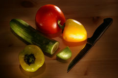 Vegetables. And knif on wood desktop Stock Photos