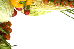 Vegetables. Fresh vegetables like red tomatoes or green cucumber on white Stock Photography