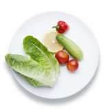 Vegetables. On a white plate, studio shot Royalty Free Stock Photography