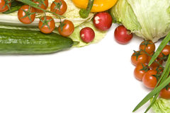 Vegetables. Fresh vegetables like red tomatoes or green cucumber on white Stock Images