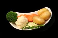Vegetables. Assorted vegetables on black background stock photos