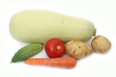 Vegetables. Vegetable marrow and other vegetables on a white background Royalty Free Stock Images