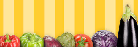 Vegetables. Composition with vegetables on a yellow lines background (panoramic Royalty Free Stock Photos
