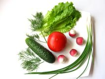 Vegetables. On the white plate Royalty Free Stock Photo