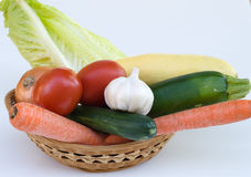 Vegetables. A few vegetables in a small basket Stock Photo