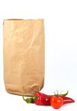 Vegetables. Space for messages, vegetables and paper bag, on white Royalty Free Stock Image