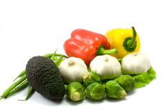 Vegetables. Avocado, garlic brussels sprouts, paprika on the white background Stock Photo