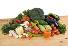 Vegetables. Variety of fresh vegetables garden stuff on kitchen wood table.Check out also stock photography