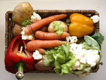Vegetables. In a basket including carrots, pepper and potatoes Stock Photography