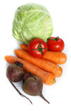 The vegetables. Three big  fresh carrots, the heads of cabbage, two  tomatoes  and two beets on the  table Royalty Free Stock Photo