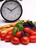 Vegetables and alarm clock Royalty Free Stock Photography