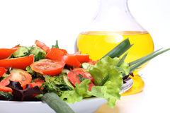 Vegetables And Oil Bottle Stock Photos