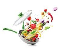 Free Vegetables Are Flying Out Of The Pan Isolated On White Background. Healthy Food Stock Images - 154479424