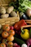 Vegetables around basket Stock Photo