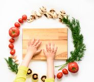 Vegetables around empty cutting board on white background, top view royalty free stock image