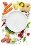 Vegetables around empty white plate Royalty Free Stock Photo