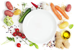 Vegetables around empty white plate Stock Photo