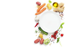 Vegetables around empty white plate Stock Photos