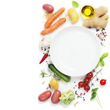 Vegetables around empty white plate Royalty Free Stock Image