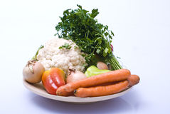 Vegetables as healthy food. Vegetables on a wooden plate, healthy food Stock Photo