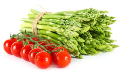 Vegetables. asparagus and tomatoes Stock Photo