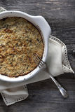 Vegetables au gratin on casserole on wooden table Royalty Free Stock Photography