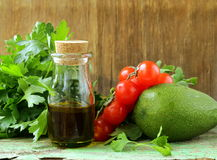 Vegetables (avocado, tomato) olive oil and herbs Royalty Free Stock Photos