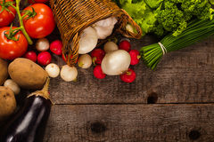 Vegetables background. Vegetables over grunge wooden background Royalty Free Stock Photo