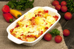 Vegetables baked with cheese in the pot on the table Stock Images