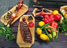 Vegetables baked on grill and meat Stock Photography