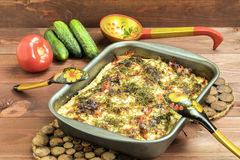 Vegetables baked with tomatoes and cucumbers. VegetVegetables baked with tomatoes and cucumbers in a rustic mannerables baked with tomatoes and cucumbers Stock Images