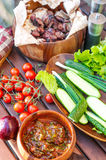 Vegetables and barbecue meat on spring weekend picnic. Stock Image