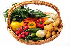 Vegetables basket. Fresh vegetables in a basket isolated on white background Stock Photography