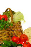 Vegetables and basket. On white background Stock Photo