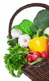 Vegetables Basket. Composition with raw vegetables and wicker basket isolated on white background. Copy space Stock Photo