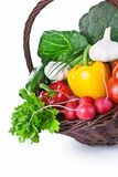 Vegetables Basket. Composition with raw vegetables in a wicker basket.  on white background Stock Images