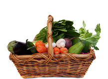Vegetables in the basket. Isolated on white royalty free stock photography
