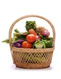 Vegetables basket. Fresh fruits and vegetables on basket Royalty Free Stock Image