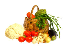 Vegetables and basket. Isolated on white background Stock Photo