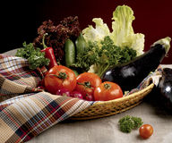 Vegetables in basket. Picture 154, salad, vegetables, basket and glass on dark background Stock Photo