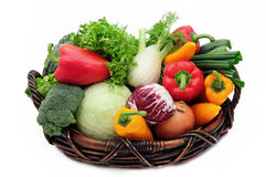 Vegetables in the basket. Isolated on white background Stock Photography
