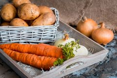 Vegetables in a basket: beets, onions, garlic, dill, potatoes, carrots on an old wooden background. Vegetables in a basket: beets, onions, garlic, dill, potatoes Stock Images