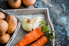 Vegetables in a basket: beets, onions, garlic, dill, potatoes, carrots on an old wooden background. Vegetables in a basket: beets, onions, garlic, dill, potatoes Stock Photos