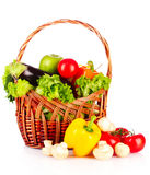 Vegetables in a basket isolated Stock Images