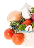 Vegetables in a basket isolated on white Stock Photo